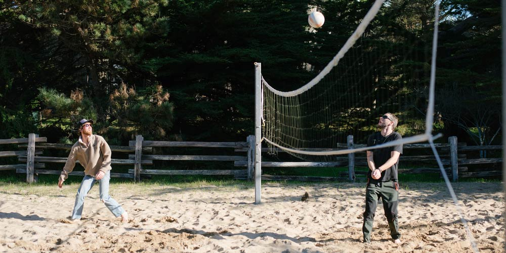 2 men playing beach volleyball