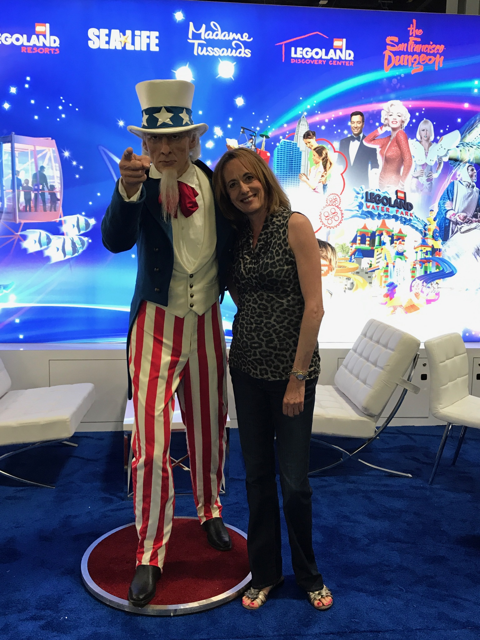 Denise Morton posing with Uncle Sam wax statue