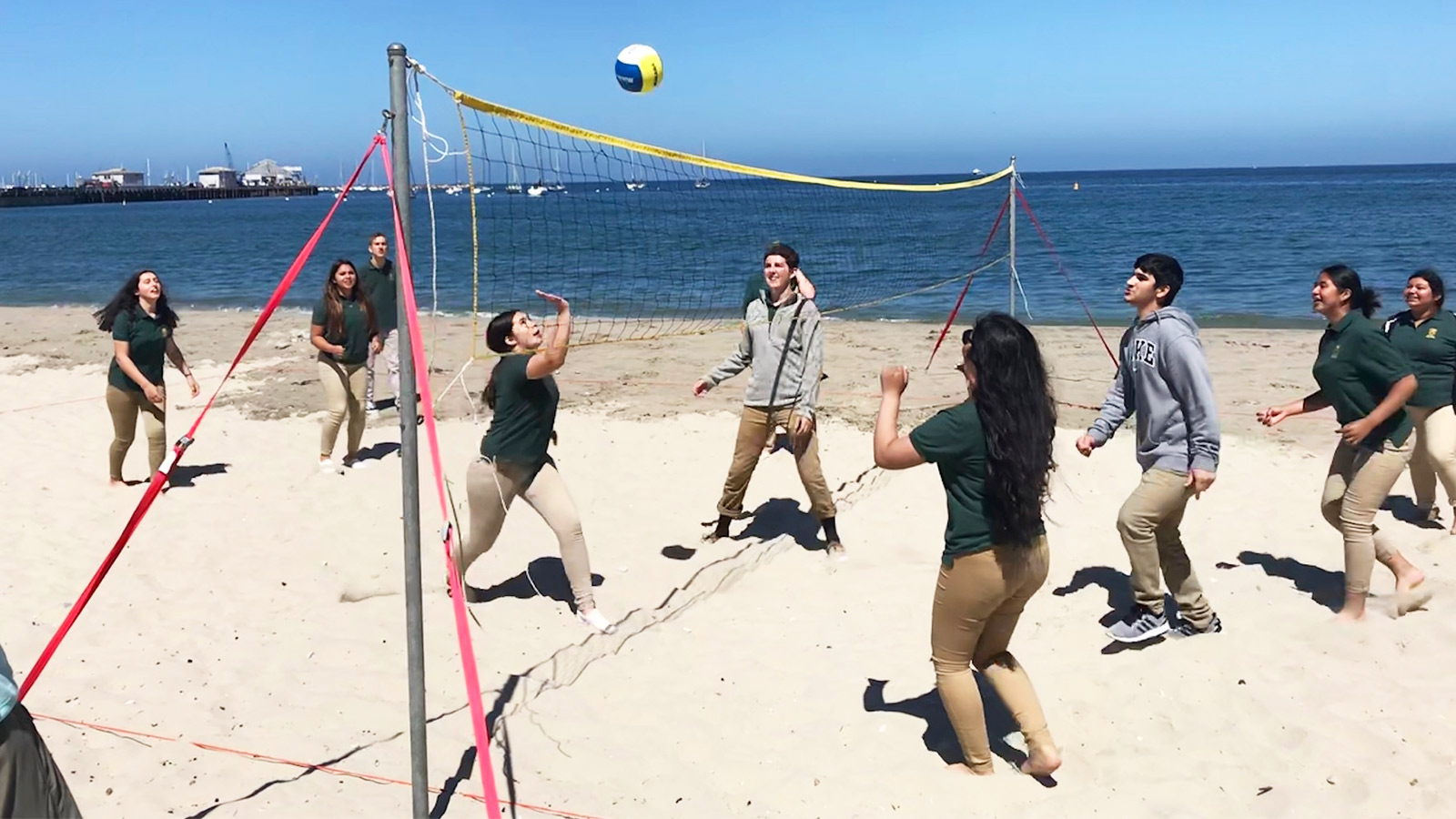 Play beach side volleyball with your team
